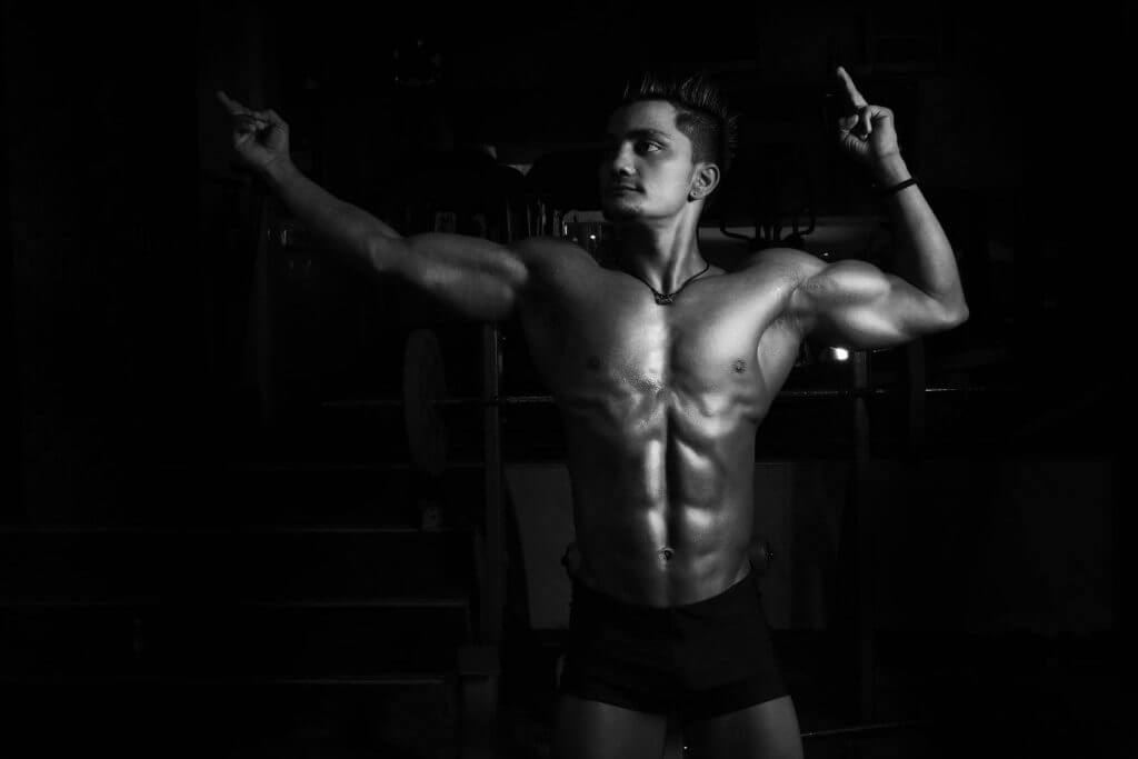 man flexing muscle and posing